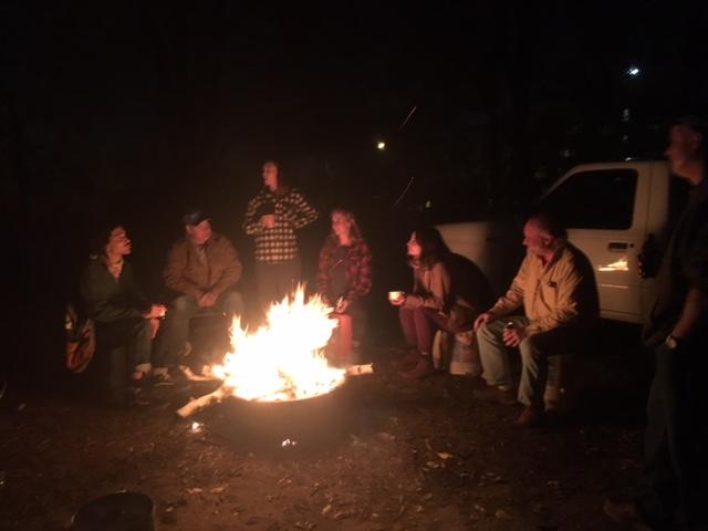 The team around a bonfire